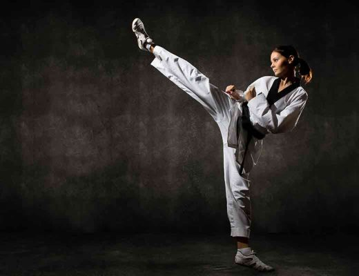 female kicking in a taekwondo uniform